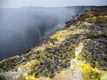 Yellow sulphur deposits and actively degassing fumaroles on the edge of the north crater in Erta Ale's summit caldera (c)