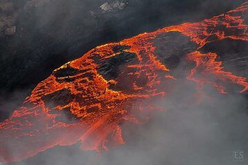 Close up of the edge of the active lava lake now deep down in the south crater of Erta Ale's summit caldera (c)