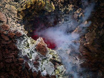 Around the edge of the south crater there are a number of small vents from which volcanic gasses and a red glow escape (Erta Ale summit caldera) (c)