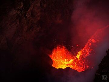 When degassing is temporarily less strong and the wind can carry away the gasses, the actively boiling lava lake at the bottom of the south crater is very spectacular (Erta Ale summit caldera) (c)