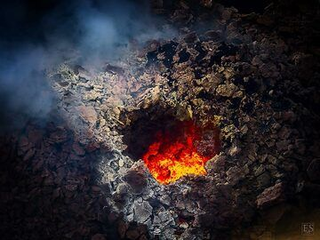Night time red glow inside one of the small active vents around the south crater of Erta Ale's summit caldera (c)