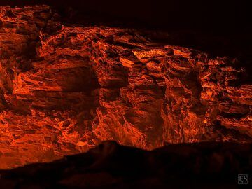 The lava's red glow reflected on the inner walls of the south crater in Erta Ale's summit caldera (c)