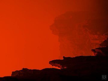 Dramatic deep red glow rising up above the edge of the south crater in Erta Ale's summit caldera (c)