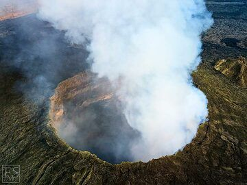 Aerial view of the south crater in Erta Ale's summit caldera and the many active fumaroles and sulphur deposits around it (c)