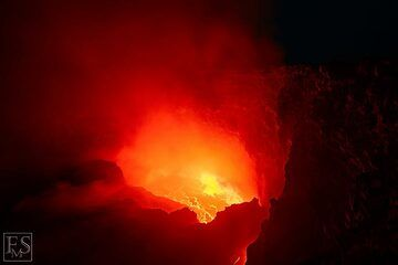 Strong degassing from the lava lake often (partially) obscures the actively boiling lava lake at the bottom of the south crater in Erta Ale's summit caldera (c)
