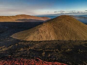 """Aerial view over part of the lava flow field and the """"observation hill"""". (Photo: World-Geographic)"""