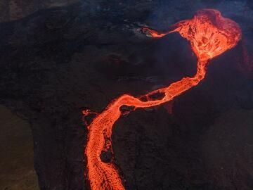 Aerial view over the active cone and the lava flow. (Photo: World-Geographic)