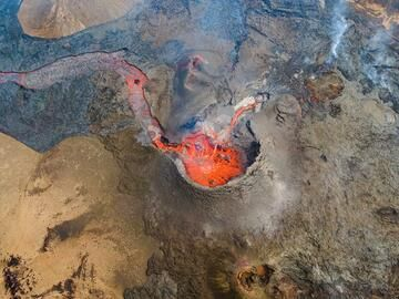 Aerial near-vertical view onto the main cone at the moment a large gas bubble explodes at the surface of the magma-filled vent. (Photo: World-Geographic)
