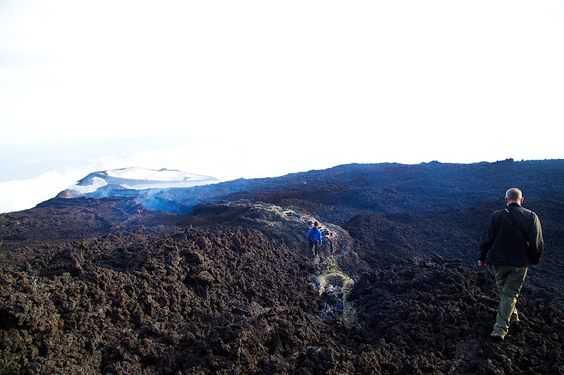Doug walking around on the upper part of the flow where the lava is roofed over. (Photo: Emanuela / VolcanoDiscovery Italia)