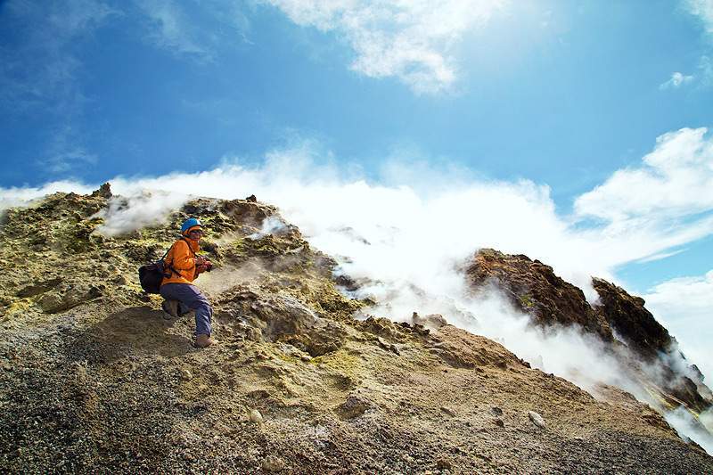 Happiness surrounded by sulfur deposits and escaping gas from fumaroles on Etna's summit craters (Photo: Emanuela / VolcanoDiscovery Italia)
