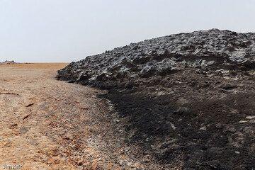 """Black mountain"", a small salt dome of dark, mud-containing salt near Dallol, Ethiopia (Photo: jimkeir)"