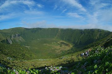 Faial's summit Caldeira seen from Canto dos Saquinhos viewpoint: note the neck at left and the cinder cone at center. The last phreatic activity occurred during the Capelinhos eruption. (Faial Island, Azores) (Photo: marcofulle)