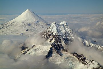 Whereas Shishaldin is a superb example of a young, symmetric stratovolcano, the much older Isanotski is irregular and deeply eroded. (Photo: marcofulle)