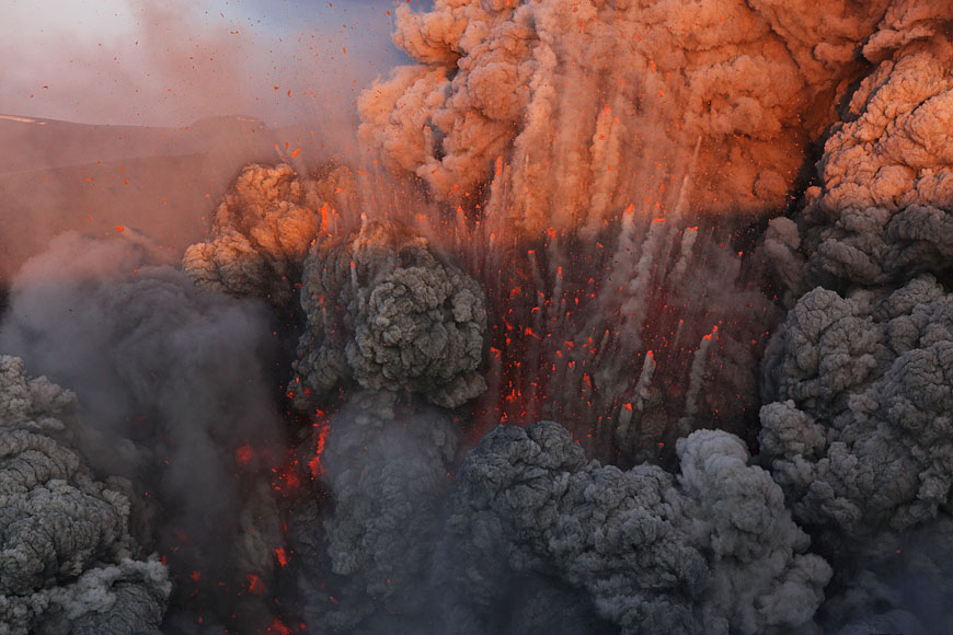 2011/44: Eyjafjallajökull, Iceland, on the 11th of May 2010. Late afternoon light shows armada of glowing lava bombs with condensation trails overtaking its ash cloud. (Photo: Martin Rietze)