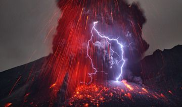Lightning in eruption column from an explosion of Sakurajima volcano, Japan (2013) (Photo: Martin Rietze)