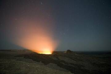 The Erta Ale gas emissions illuminated by the glowing lava lake inside the pit. (Photo: shinkov)
