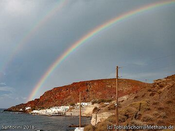 """Rainbow over the cinder cone of the """"red beach"""" at Acrotiri. (Photo: Tobias Schorr)"""
