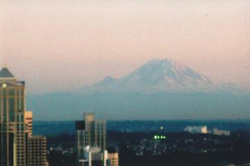 Mount Rainier, Washington, at sunset from downtown Seattle (top of the Space Needle). 5 October, 2009 (Photo: volcanomike)