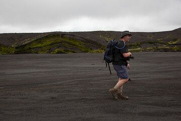Hiking along one of the major flash flood beds cutting through the ash deposits of the caldera.  (Photo: Tom Pfeiffer)