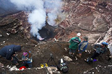 Our expedition group perched on a ledge above the craters inside Benbow (Ambrym volcano, Vanuatu) (Photo: Tom Pfeiffer)