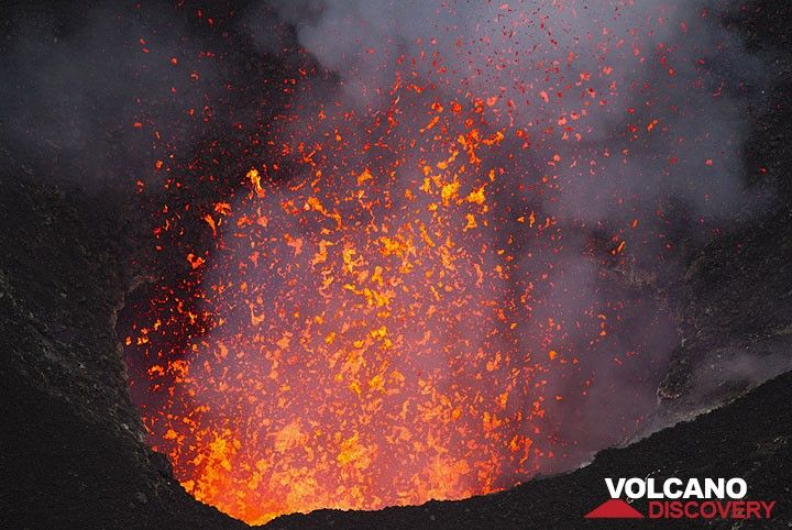 Liquid spatter is ejected several meters above the crater rim of the south pit when larger gas bubbles burst at the surface of the lava lake. (Photo: Tom Pfeiffer)