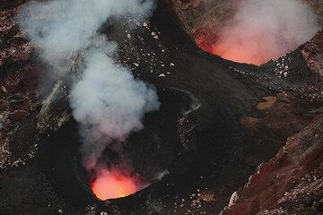 South (l) and North (r) vents inside Benbow crater, both containing small lava lakes. (Photo: Tom Pfeiffer)