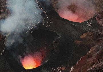 The south and north pit craters containing little lava lakes. Spattering from the south vent is well visible, while the north pit is too deep for us to see the lava inside. (Photo: Tom Pfeiffer)