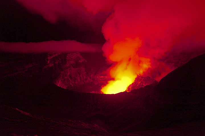 The crater of Bembow illuminated by its lava lakes at night. (Photo: Tom Pfeiffer)