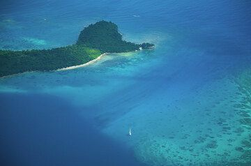 Coral sea between Epi Island (above in picture) and Tongoa Island. (Photo: Tom Pfeiffer)