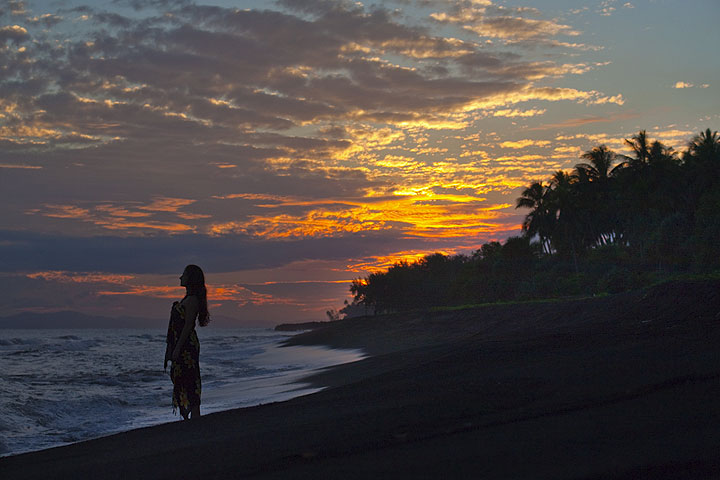 Sihouette of a woman at the beach against sunset (Photo: Tom Pfeiffer)