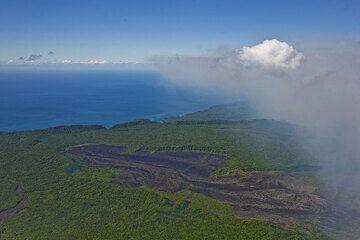 Ambrym's volcanic gas plume rich in bluish SO2 drifting eastwards. (Photo: Tom Pfeiffer)
