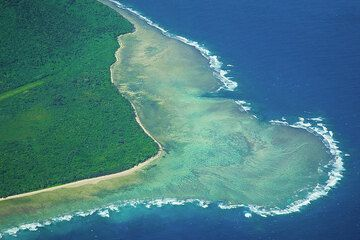 The coral reef at the western tip of Emae and part of its airstrip. (Photo: Tom Pfeiffer)