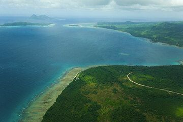 View East over Undine Bay and part of the North coast of Efate Island. Tiny Kakula and Pele Islands to the left and Emao Island in the background. (Photo: Tom Pfeiffer)