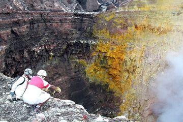 Looking into one of the deep pit craters inside Bembow volcano, Ambrym (Vanuatu). The northern wall is crusted over with yellow sulfur deposits mostly from sublimation of the fumes emanating from the lava lake. Taken during the recent expedition to Vanuatu. (Photo: Yashmin Chebli)