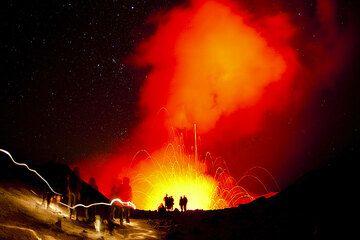 Approaching the active crater of Yasur volcano (Tanna Island, Vanuatu) at night (Photo: Tom Pfeiffer)