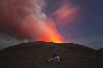 Jorge observing Yasur from the parking lot. We are not sure if it is safe enough to climb up, so we wait for a while to observe the activity. (Photo: Tom Pfeiffer)