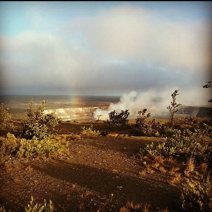 Halema'uma'u crater with rainbow coming out of it