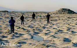 Group at a mud volcano. (Photo: Ronnie Gallagher)
