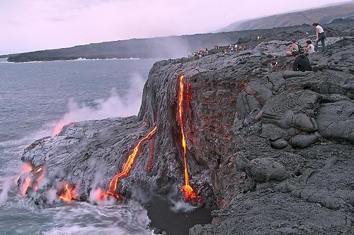 Lava from Kilauea Volcano flows into the Pacific Ocean. (David / Jordan AP press photo)