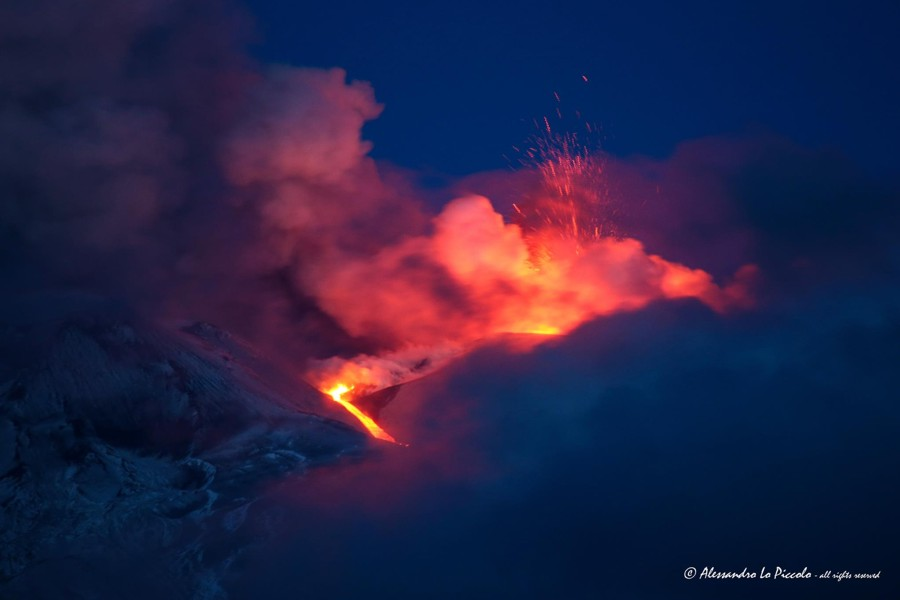The photo above at left, courtesy of Alessandro Lo Piccolo, shows the explosive activity at the Voragine at right, and the little lava flow further left, which had advanced a few hundred meters.