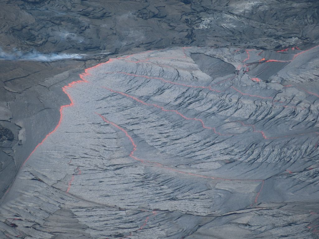 A close up view of the inlet at the western margin of the lava lake in Halema'uma'u Crater, at the summit of Kīlauea. The lava stream was covered in a thin, flexible crust and was moving at a very slow velocity. (Image & caption: USGS-HVO; M. Patrick, April 13, 2021.)