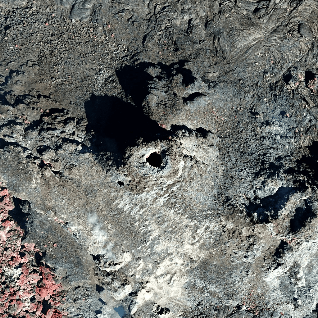 This Unoccupied Aircraft Systems (UAS) photo, looking straight down into the inactive western fissure within Halema'uma'u at the summit of Kīlauea, was captured on Thursday, June 3, 2021. One of the objectives of the UAS mission was to get a close-up look into the fissure to see if any incandescent lava was still visible. As evidenced by the darkness within the opening atop the fissure (center of frame), no active lava was observed. For scale, the height and width of this photo each span approximately 40 m (131 ft) laterally. (USGS image & caption.)