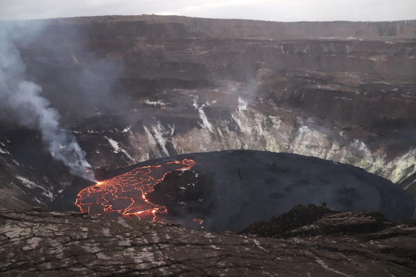 Picture shows the active western (left) portion of the lava lake, which has hot incandescent lava visible at boundaries between plates on the lava lake. The inactive eastern (right) portion of the lake appears dark (image: HVO)
