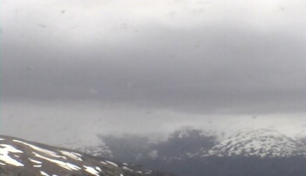 Visibility of Hudson volcano was very limited due to dense clouds in the imagery (image: SERNAGEOMIN)