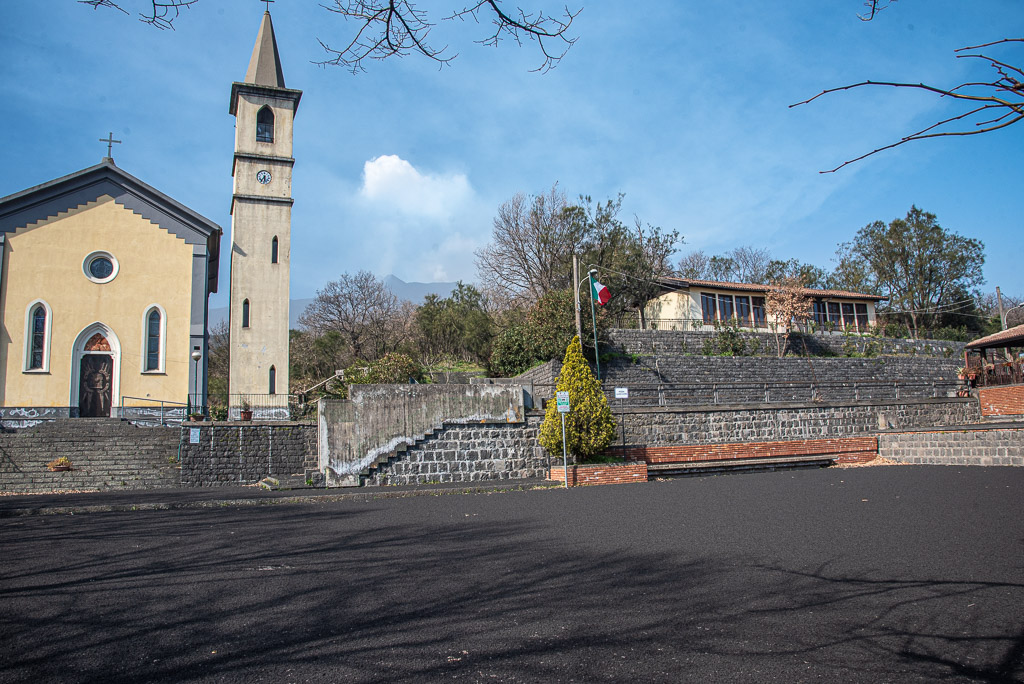 Square in Fornazzo village covered with black lapilli (image: Tom Pfeiffer / VolcanoDiscovery)