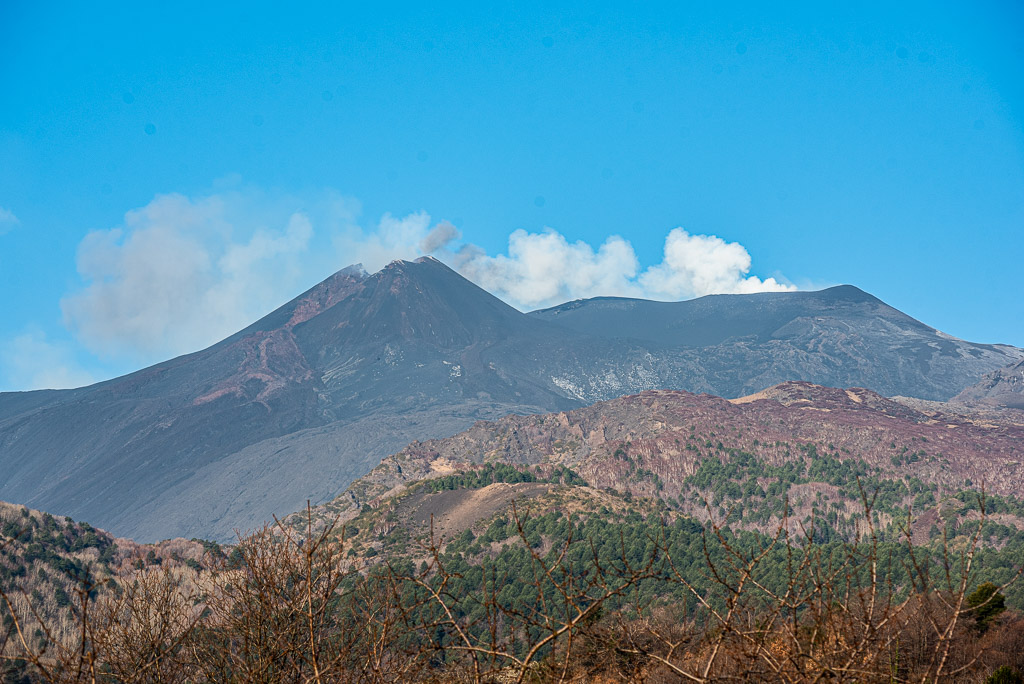 Etna's summit region seen from the east this morning. New SE crater to the left, and a small ash plume emitted from the Voragine (center) is visible.