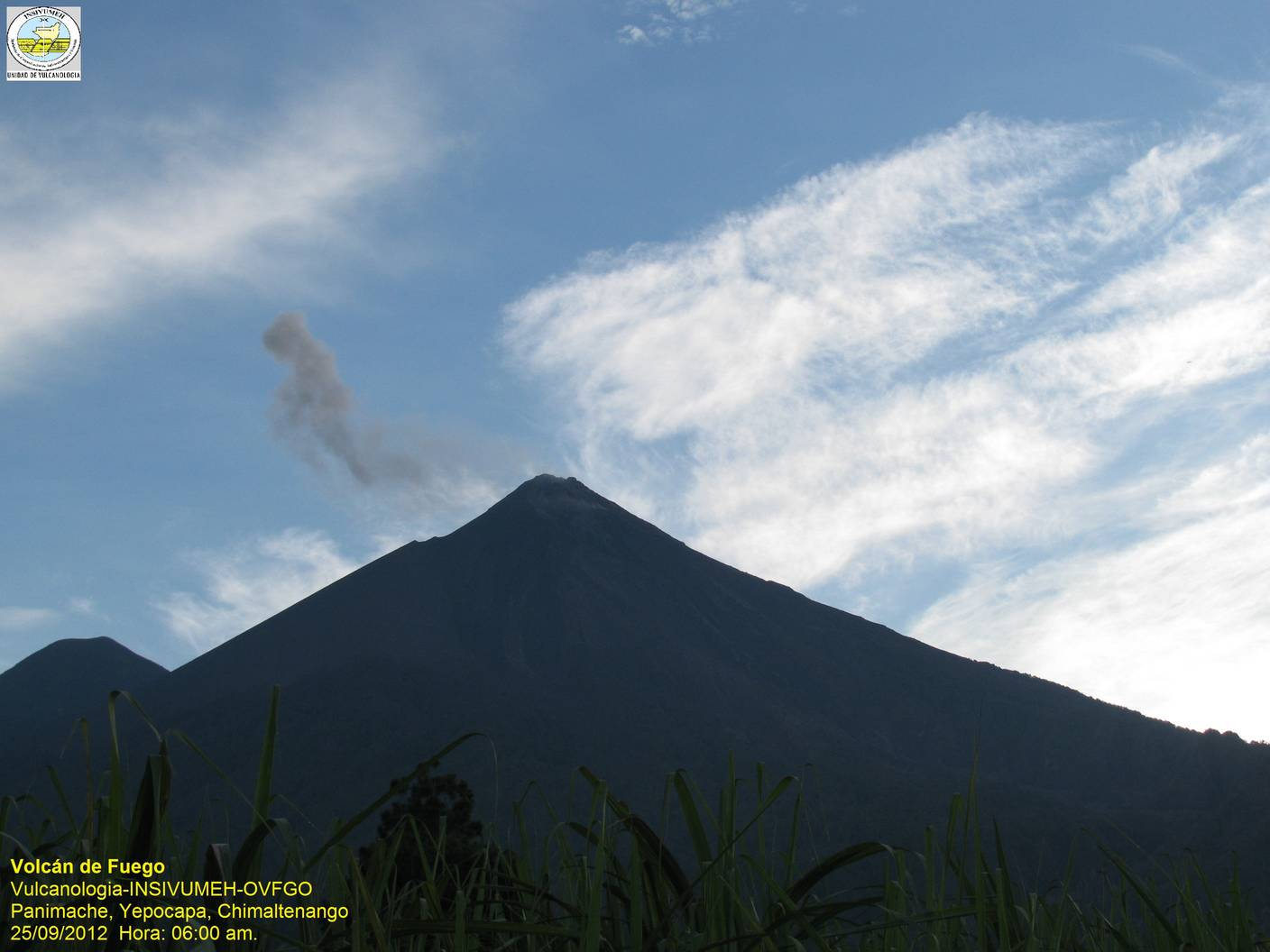 Fuego volcano with a small blast ash cloud seen from the observatory
