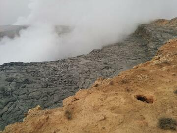 A plume of volcanic gasses rises up from the South Crater, obstructing the view of the lava lake inside during the day time (image: Simeon Brown)