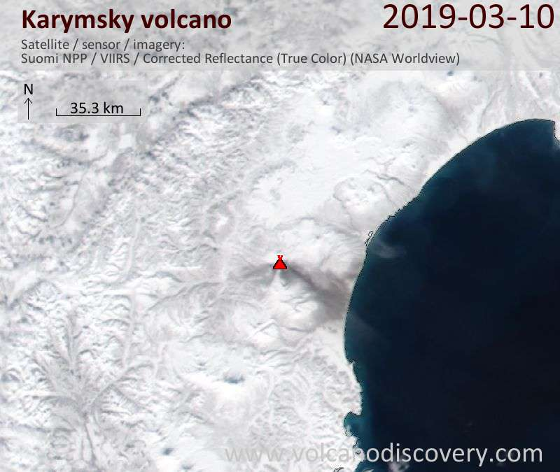 Satellite image of Karymsky showing the ash deposit east of the volcano as gray layer