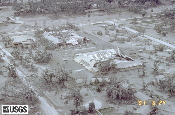 Aerial view of part of Clark Air Base showing buildings and vegetation damaged by tephra (ash) fall of 15 June, 1991. U.S. Geological Survey Photograph taken on June 24, 1991, by Willie Scott.